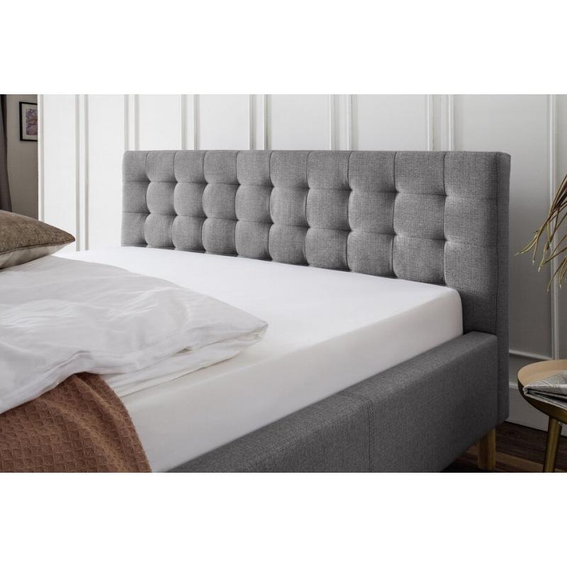 120 arba 140 cm lova, dygsniuotu galvūgaliu, su natūralaus medžio kojelėmis